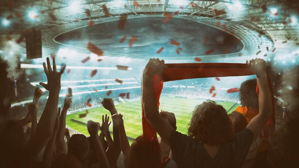 Euro 2020. Crowd cheering on the stadium stands.