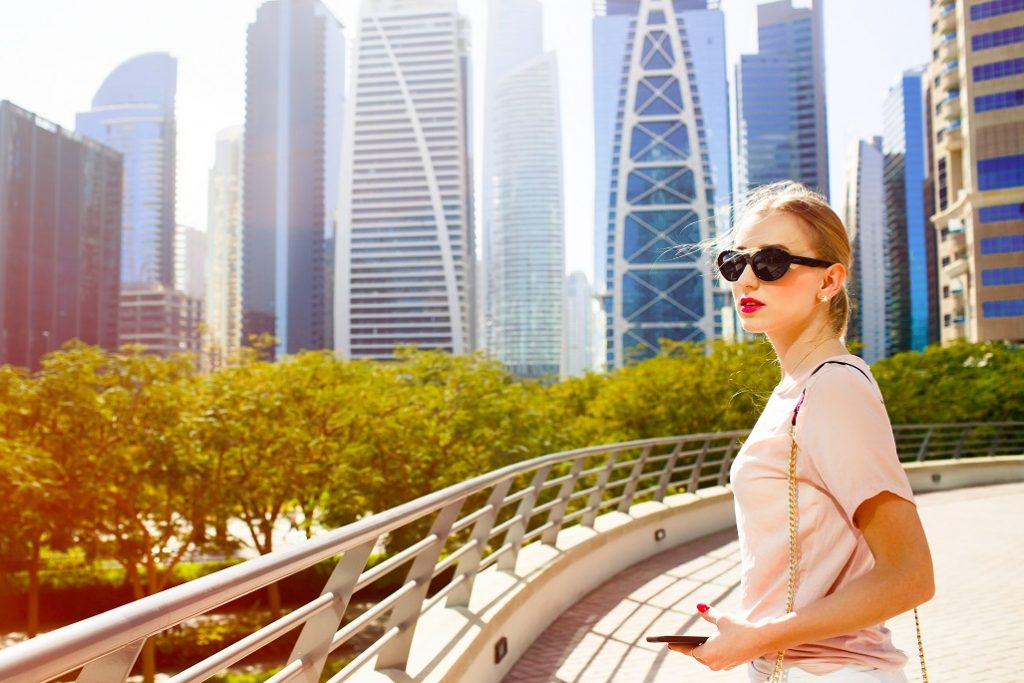 Woman in Dubai Outside Under the Skyscrappers