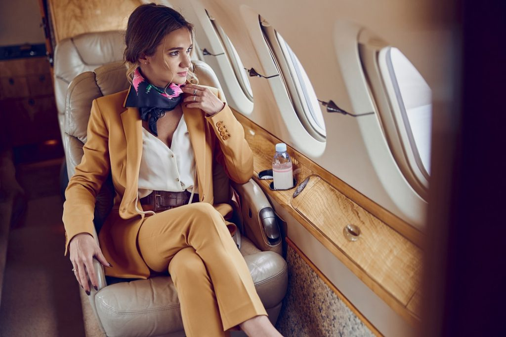 Businesswoman Looking out the Window on a Private Jet Flight